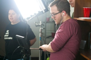Director Jonothan Carpenter checks the monitor to frame a shot.