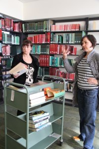 Director Amy Harrison and Production Designer Alex Dixon putting far more thought into the library location than I had.