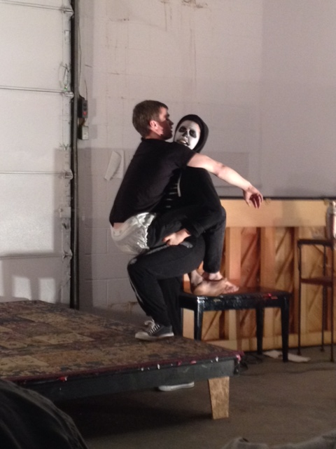 Savannah Reich as the Skeleton carrying Jeremy Hois as the Baby in the Pittsburgh performance workshop at the Irma Freeman Center for the Imagination directed by Dan Giles in February 2014.