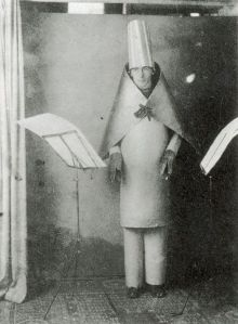 Hugo Ball performing at Cabaret Voltaire in 1916. (This costume gets re-created in ZURICH PLAYS!)