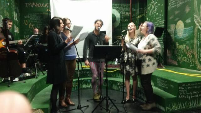 "Clare Prowse, Marissa Skudlarek, Sam Cohen, Juliana Lustenader, and Amanda Ortmayer rehearsing ""Sensation"" on the co-opted set of ""Dead Dog's Bone"""