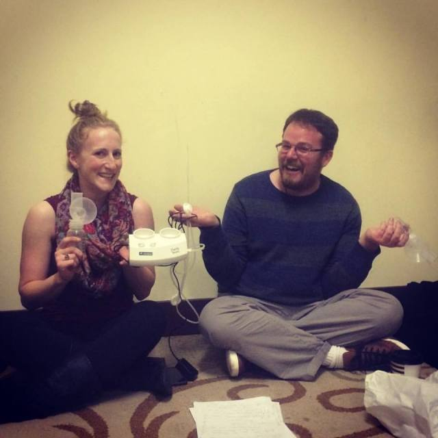Caitlin Evenson and director Stuart Bousel pose with the Breast Pump That Never Goes Out.